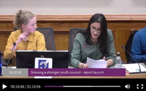 Young Commissioners introducing the report