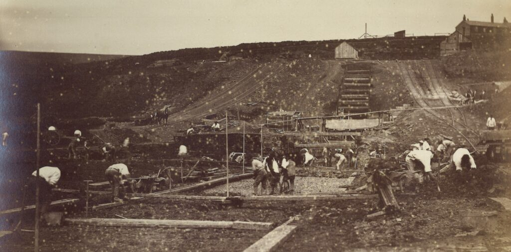 Photograph of Puddlers lining the bottom of Wessenden Head Reservoir in 1881 to make it waterproof
